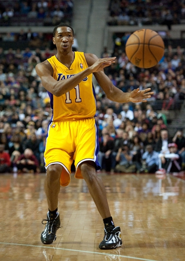 Nov 29, 2013; Auburn Hills, MI, USA; Los Angeles Lakers shooting guard Wesley Johnson (11) pass the ball during the second quarter against the Detroit Pistons at The Palace of Auburn Hills. Mandatory Credit: Tim Fuller-USA TODAY Sports