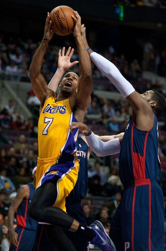 Nov 29, 2013; Auburn Hills, MI, USA; Los Angeles Lakers small forward Xavier Henry (7) goes to the basket against the Detroit Pistons during the second quarter at The Palace of Auburn Hills. Mandatory Credit: Tim Fuller-USA TODAY Sports
