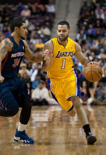 Nov 29, 2013; Auburn Hills, MI, USA; Detroit Pistons point guard Peyton Siva (34) guards Los Angeles Lakers point guard Jordan Farmar (1) during the first quarter at The Palace of Auburn Hills. Mandatory Credit: Tim Fuller-USA TODAY Sports