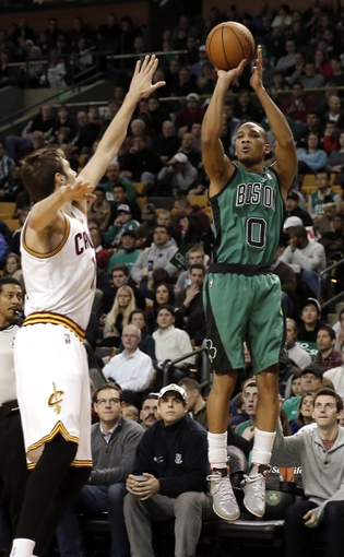Nov 29, 2013; Boston, MA, USA; Boston Celtics point guard Avery Bradley (0) shoots over Cleveland Cavaliers shooting guard Matthew Dellavedova (9) during the first quarter at TD Garden. Mandatory Credit: Winslow Townson-USA TODAY Sports