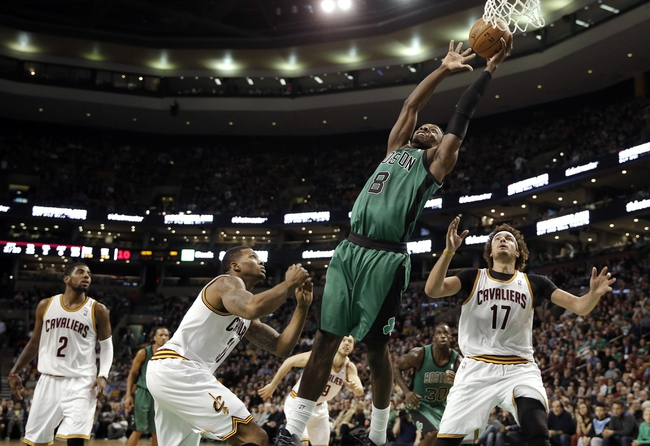 Nov 29, 2013; Boston, MA, USA; Boston Celtics shooting guard Jeff Green (8) grabs a pass near the rim behind Cleveland Cavaliers point guard Kyrie Irving (2), shooting guard Dion Waiters (3) and center Anderson Varejao (17) during the second quarter at TD Garden. Mandatory Credit: Winslow Townson-USA TODAY Sports