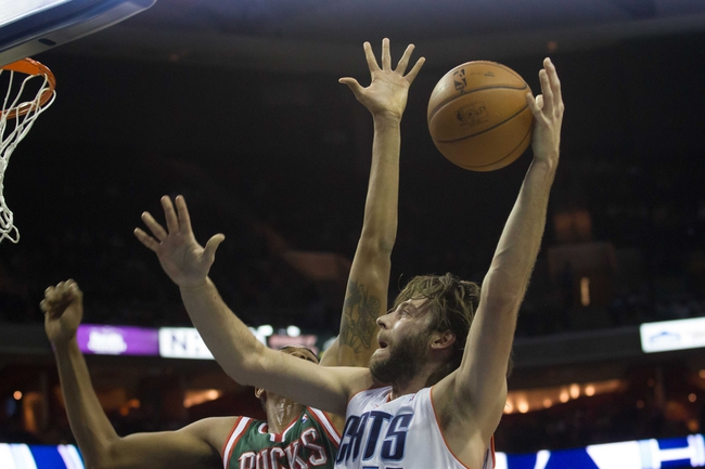 Nov 29, 2013; Charlotte, NC, USA; Charlotte Bobcats power forward Josh McRoberts (11) shoots the ball while Milwaukee Bucks power forward John Henson (31) defends during the second half at Time Warner Cable Arena. Bobcats defeated the Bucks 92-76. Mandatory Credit: Jeremy Brevard-USA TODAY Sports