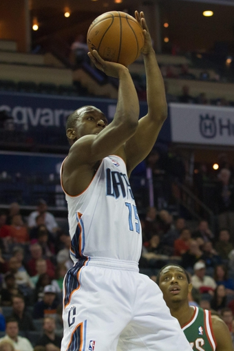 Nov 29, 2013; Charlotte, NC, USA; Charlotte Bobcats point guard Kemba Walker (15) shoots the ball during the second half against the Milwaukee Bucks at Time Warner Cable Arena. Bobcats defeated the Bucks 92-76. Mandatory Credit: Jeremy Brevard-USA TODAY Sports