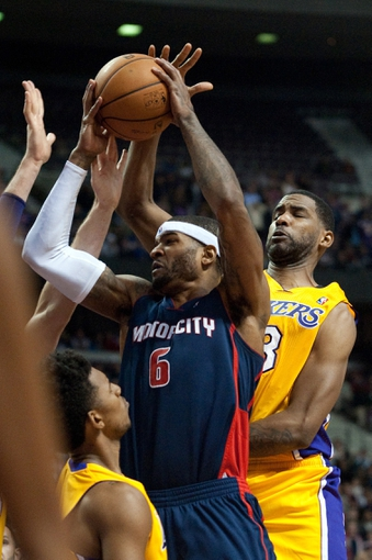 Nov 29, 2013; Auburn Hills, MI, USA; Detroit Pistons small forward Josh Smith (6) fouls Los Angeles Lakers small forward Nick Young (0) during the fourth quarter at The Palace of Auburn Hills. Lakers won 106-102. Mandatory Credit: Tim Fuller-USA TODAY Sports