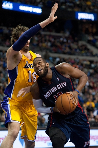 Nov 29, 2013; Auburn Hills, MI, USA; Los Angeles Lakers center Pau Gasol (16) guards Detroit Pistons power forward Greg Monroe (10) during the third quarter at The Palace of Auburn Hills. Lakers won 106-102. Mandatory Credit: Tim Fuller-USA TODAY Sports