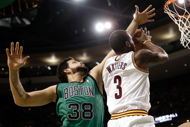 Nov 29, 2013; Boston, MA, USA; Cleveland Cavaliers shooting guard Dion Waiters (3) has his layup attempt blocked by Boston Celtics center Vitor Faverani (38) during the second half of Boston's 103-86 win at TD Garden. Mandatory Credit: Winslow Townson-USA TODAY Sports