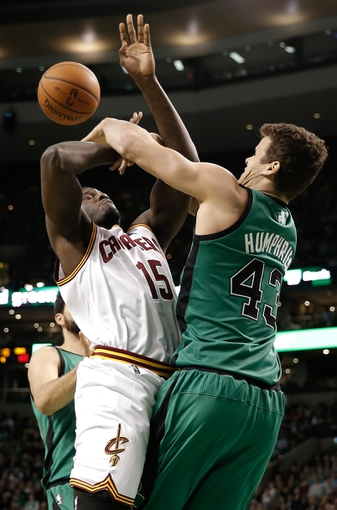 Nov 29, 2013; Boston, MA, USA; Boston Celtics power forward Kris Humphries (43) bats the ball away from Cleveland Cavaliers small forward Anthony Bennett (15) during the second half of Boston's 103-86 win at TD Garden. Mandatory Credit: Winslow Townson-USA TODAY Sports