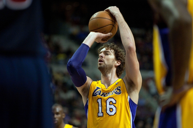 Nov 29, 2013; Auburn Hills, MI, USA; Los Angeles Lakers center Pau Gasol (16) shoots a free throw during the second quarter against the Detroit Pistons at The Palace of Auburn Hills. Mandatory Credit: Tim Fuller-USA TODAY Sports
