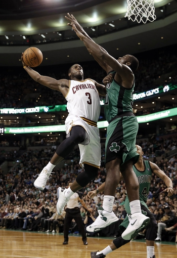 Nov 29, 2013; Boston, MA, USA; Cleveland Cavaliers guard Dion Waiters (3) goes to the basket against Boston Celtics power forward Brandon Bass (30) during the second half of Boston's 103-86 win at TD Garden. Mandatory Credit: Winslow Townson-USA TODAY Sports