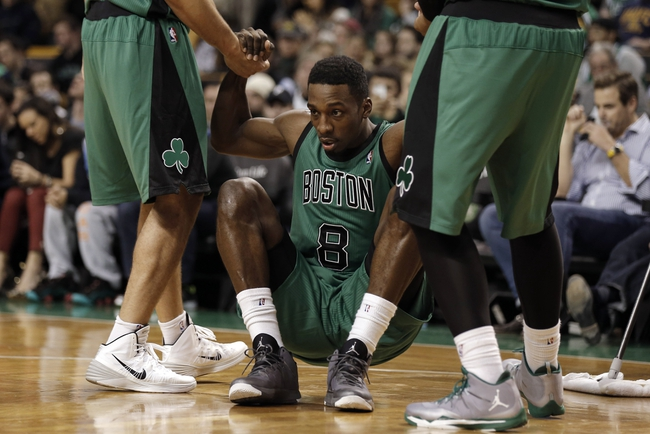 Nov 29, 2013; Boston, MA, USA; Boston Celtics shooting guard Jeff Green (8) is helped up by teammates during the second half of Boston's 103-86 win over the Cleveland Cavaliers at TD Garden. Mandatory Credit: Winslow Townson-USA TODAY Sports