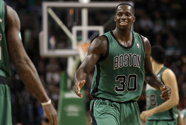 Nov 29, 2013; Boston, MA, USA; Boston Celtics power forward Brandon Bass (30) gets congratulated by a teammate during the second half of Boston's 103-86 win over the Cleveland Cavaliers at TD Garden. Mandatory Credit: Winslow Townson-USA TODAY Sports