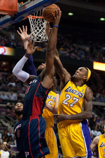 Nov 29, 2013; Auburn Hills, MI, USA; Los Angeles Lakers center Jordan Hill (27) attempts to block Detroit Pistons power forward Greg Monroe (10) during the third quarter at The Palace of Auburn Hills. Lakers won 106-102. Mandatory Credit: Tim Fuller-USA TODAY Sports