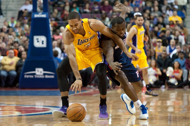 Nov 29, 2013; Auburn Hills, MI, USA; Los Angeles Lakers small forward Xavier Henry (7) and Detroit Pistons shooting guard Rodney Stuckey (3) battle for a lose ball during the fourth quarter at The Palace of Auburn Hills. Lakers won 106-102. Mandatory Credit: Tim Fuller-USA TODAY Sports