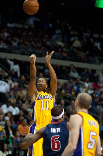 Nov 29, 2013; Auburn Hills, MI, USA; Los Angeles Lakers shooting guard Wesley Johnson (11) shoots during the first quarter against the Detroit Pistons at The Palace of Auburn Hills. Mandatory Credit: Tim Fuller-USA TODAY Sports