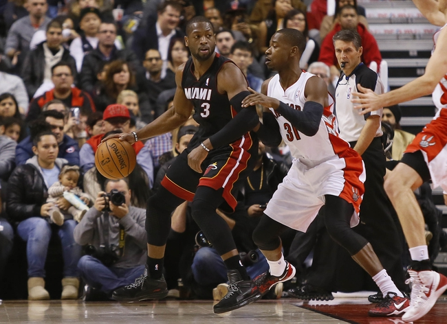 Nov 29, 2013; Toronto, Ontario, CAN; Miami Heat guard Dwyane Wade (3) carries the ball against Toronto Raptors guard Terrence Ross (31) during the first half at the Air Canada Centre. Mandatory Credit: John E. Sokolowski-USA TODAY Sports