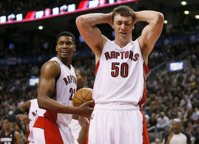 Nov 29, 2013; Toronto, Ontario, CAN; Toronto Raptors forward Tyler Hansbrough (50) and forward Rudy Gay (22) react to a foul call against the Miami Heat at the Air Canada Centre. Miami defeated Toronto 90-83. Mandatory Credit: John E. Sokolowski-USA TODAY Sports