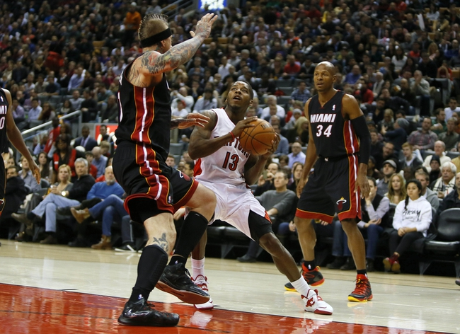 Nov 29, 2013; Toronto, Ontario, CAN; Toronto Raptors guard Dwight Buycks (13) looks to shoot as Miami Heat forward-center Chris Andersen (11) defends and guard Ray Allen (34) looks on during the first half at the Air Canada Centre. Mandatory Credit: John E. Sokolowski-USA TODAY Sports