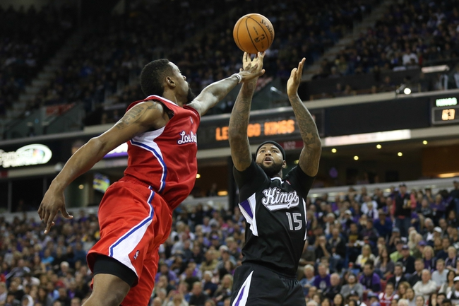 Nov 29, 2013; Sacramento, CA, USA; Sacramento Kings center DeMarcus Cousins (15) shoots the ball against Los Angeles Clippers center DeAndre Jordan (6) during the third quarter at Sleep Train Arena. The Los Angeles Clippers defeated the Sacramento Kings 104-98 in overtime. Mandatory Credit: Kelley L Cox-USA TODAY Sports