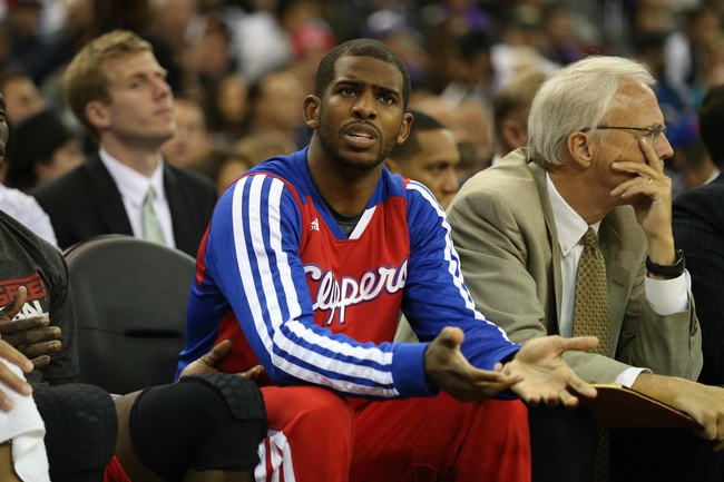 Nov 29, 2013; Sacramento, CA, USA; Los Angeles Clippers point guard Chris Paul (3) questions the referee from the bench during the fourth quarter against the Sacramento Kings at Sleep Train Arena. The Los Angeles Clippers defeated the Sacramento Kings 104-98 in overtime. Mandatory Credit: Kelley L Cox-USA TODAY Sports