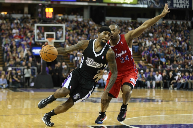 Nov 29, 2013; Sacramento, CA, USA; Sacramento Kings small forward John Salmons (5) drives in against Los Angeles Clippers shooting guard Willie Green (34) during the fourth quarter at Sleep Train Arena. The Los Angeles Clippers defeated the Sacramento Kings 104-98 in overtime. Mandatory Credit: Kelley L Cox-USA TODAY Sports