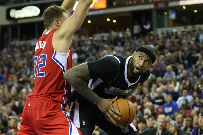Nov 29, 2013; Sacramento, CA, USA; Sacramento Kings center DeMarcus Cousins (15) looks to the basket against Los Angeles Clippers power forward Blake Griffin (32) during the fourth quarter at Sleep Train Arena. The Los Angeles Clippers defeated the Sacramento Kings 104-98 in overtime. Mandatory Credit: Kelley L Cox-USA TODAY Sports