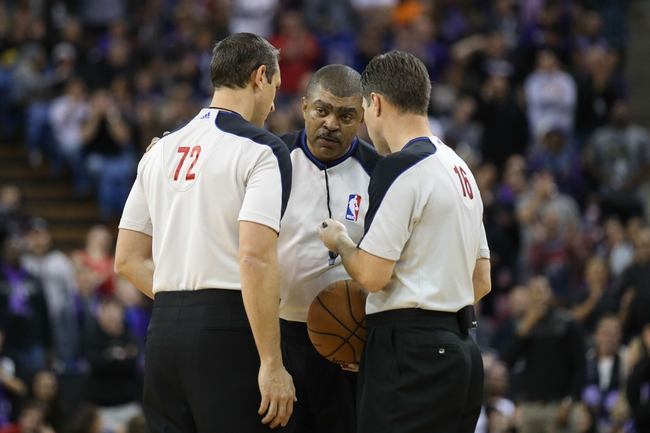 Nov 29, 2013; Sacramento, CA, USA; NBA referees JT Orr (72), Tony Brothers (25) and David Guthrie (16) discuss a call during the fourth quarter between the Sacramento Kings and the Los Angeles Clippers at Sleep Train Arena. The Los Angeles Clippers defeated the Sacramento Kings 104-98 in overtime. Mandatory Credit: Kelley L Cox-USA TODAY Sports