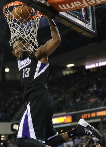 Nov 29, 2013; Sacramento, CA, USA; Sacramento Kings forward Derrick Williams (13) dunks the ball against the Los Angeles Clippers during the fourth quarter at Sleep Train Arena. The Los Angeles Clippers defeated the Sacramento Kings 104-98 in overtime. Mandatory Credit: Kelley L Cox-USA TODAY Sports