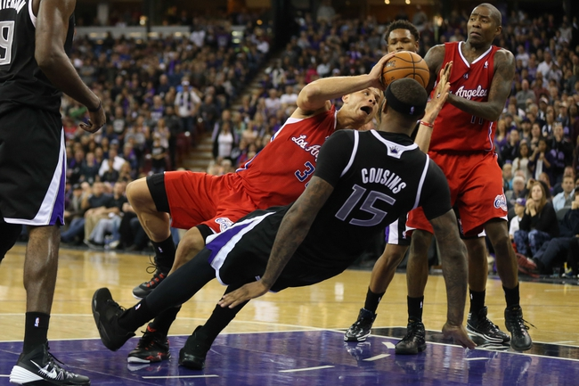 Nov 29, 2013; Sacramento, CA, USA; Sacramento Kings center DeMarcus Cousins (15) is called for a loose ball foul against Los Angeles Clippers power forward Blake Griffin (32) during the fourth quarter at Sleep Train Arena. The Los Angeles Clippers defeated the Sacramento Kings 104-98 in overtime. Mandatory Credit: Kelley L Cox-USA TODAY Sports