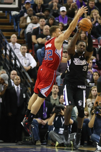 Nov 29, 2013; Sacramento, CA, USA; Sacramento Kings power forward Patrick Patterson (9) pulls in a rebound against Los Angeles Clippers power forward Blake Griffin (32) during the overtime period at Sleep Train Arena. The Los Angeles Clippers defeated the Sacramento Kings 104-98 in overtime. Mandatory Credit: Kelley L Cox-USA TODAY Sports