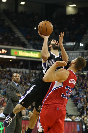 Nov 29, 2013; Sacramento, CA, USA; Sacramento Kings point guard Greivis Vasquez (10) scores a three point basket against Los Angeles Clippers power forward Blake Griffin (32) during the fourth quarter at Sleep Train Arena. The Los Angeles Clippers defeated the Sacramento Kings 104-98 in overtime. Mandatory Credit: Kelley L Cox-USA TODAY Sports