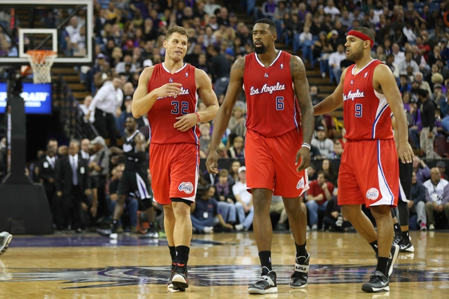 Nov 29, 2013; Sacramento, CA, USA; Los Angeles Clippers power forward Blake Griffin (32). center DeAndre Jordan (6) and small forward Jared Dudley (9) walk to the bench as a timeout is called against the Sacramento Kings during the overtime period at Sleep Train Arena. The Los Angeles Clippers defeated the Sacramento Kings 104-98 in overtime. Mandatory Credit: Kelley L Cox-USA TODAY Sports