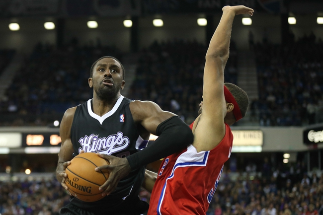 Nov 29, 2013; Sacramento, CA, USA; Sacramento Kings power forward Patrick Patterson (9) controls the ball for a basket against Los Angeles Clippers small forward Jared Dudley (9) during the overtime period at Sleep Train Arena. The Los Angeles Clippers defeated the Sacramento Kings 104-98 in overtime. Mandatory Credit: Kelley L Cox-USA TODAY Sports