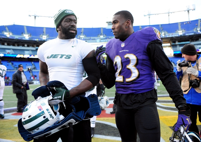 Nov 24, 2013; Baltimore, MD, USA; New York Jets safety Ed Reed (left) talks to Baltimore Ravens cornerback Chykie Brown (right) after the game at M&T Bank Stadium. Mandatory Credit: Evan Habeeb-USA TODAY Sports