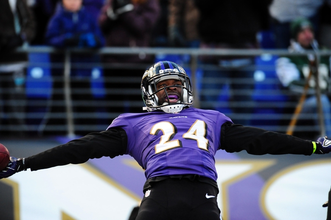 Nov 24, 2013; Baltimore, MD, USA; Baltimore Ravens cornerback Corey Graham (24) reacts after intercepting a pass during the game against the New York Jets at M&T Bank Stadium. Mandatory Credit: Evan Habeeb-USA TODAY Sports