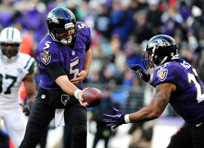 Nov 24, 2013; Baltimore, MD, USA; Baltimore Ravens quarterback Joe Flacco (5) hands the ball off to running back Ray Rice (27) during the game against the New York Jets at M&T Bank Stadium. Mandatory Credit: Evan Habeeb-USA TODAY Sports