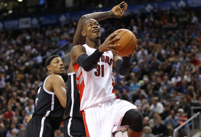 Nov 26, 2013; Toronto, Ontario, CAN; Toronto Raptors guard Terrence Ross (31) goes up with the ball against the Brooklyn Nets at Air Canada Centre. The Nets beat the Raptors 102-100. Mandatory Credit: Tom Szczerbowski-USA TODAY Sports