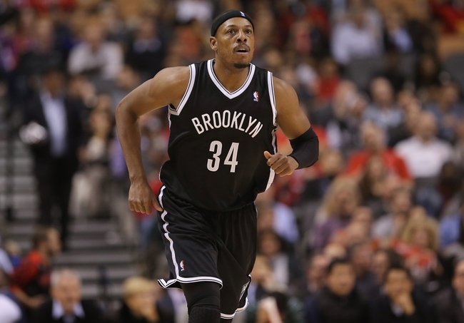Nov 26, 2013; Toronto, Ontario, CAN; Brooklyn Nets forward Paul Pierce (34) against the Toronto Raptors at Air Canada Centre. The Nets beat the Raptors 102-100. Mandatory Credit: Tom Szczerbowski-USA TODAY Sports