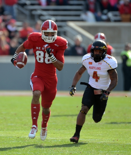 Nov 30, 2013; Raleigh, NC, USA; North Carolina State Wolfpack receiver Quintin Payton (88) runs after a first half catch as Maryland Terrapins defensive back William Likely (4) pursues at Carter Finley Stadium. Mandatory Credit: Rob Kinnan-USA TODAY Sports