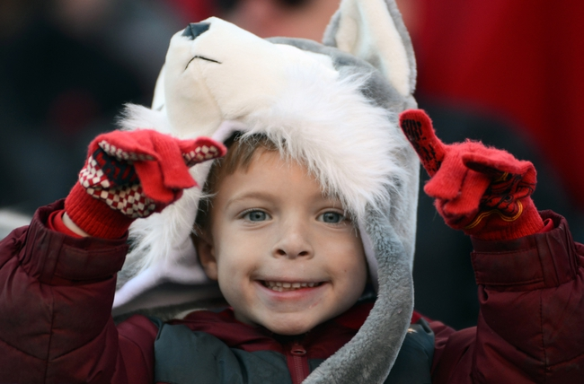 Nov 30, 2013; Raleigh, NC, USA; A young North Carolina State Wolfpack fan cheers during the first half against the Maryland Terrapins at Carter Finley Stadium. Mandatory Credit: Rob Kinnan-USA TODAY Sports