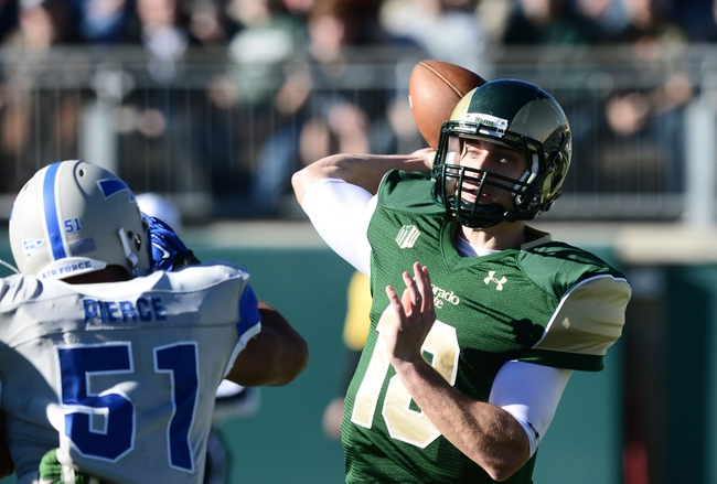 Nov 30, 2013; Fort Collins, CO, USA; Air Force Falcons linebacker Jordan Pierce (51) pressures a pass by Colorado State Rams quarterback Garrett Grayson (18) in the first quarter at Hughes Stadium. Mandatory Credit: Ron Chenoy-USA TODAY Sports