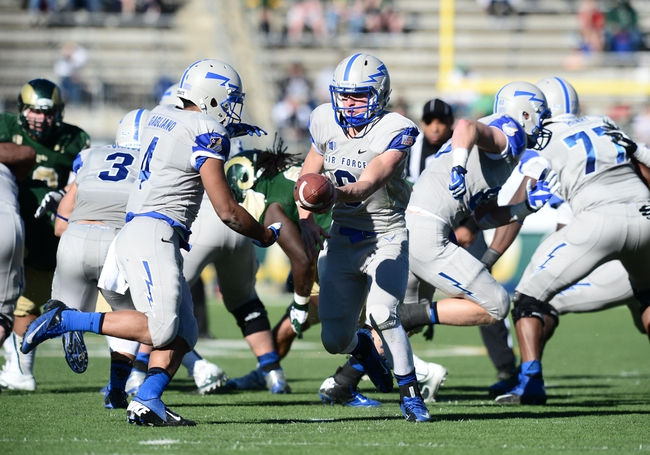 Nov 30, 2013; Fort Collins, CO, USA; Air Force Falcons quarterback Nate Romine (6) hands off to wide receiver Sam Gagliano (4) in the first quarter against the Colorado State Rams at Hughes Stadium. Mandatory Credit: Ron Chenoy-USA TODAY Sports