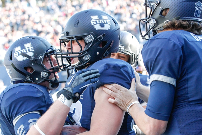 Nov 30, 2013; Logan, UT, USA; Utah State Aggies tight end Wyatt Houston (83) celebrates with his team after scoring a touch down against the Wyoming Cowboys in the first quarter at Romney Stadium. Mandatory Credit: Chris Nicoll-USA TODAY Sports