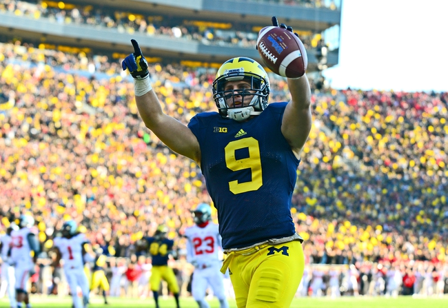 Nov 30, 2013; Ann Arbor, MI, USA; Michigan Wolverines wide receiver Drew Dileo (9) catches a pass in the end zone for a touchdown during the fourth quarter against the Ohio State Buckeyes at Michigan Stadium. Mandatory Credit: Andrew Weber-USA TODAY Sports