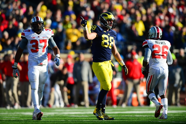 Nov 30, 2013; Ann Arbor, MI, USA; Michigan Wolverines tight end Jake Butt (88) gestures a first down during the fourth quarter against the Ohio State Buckeyes at Michigan Stadium. Mandatory Credit: Andrew Weber-USA TODAY Sports