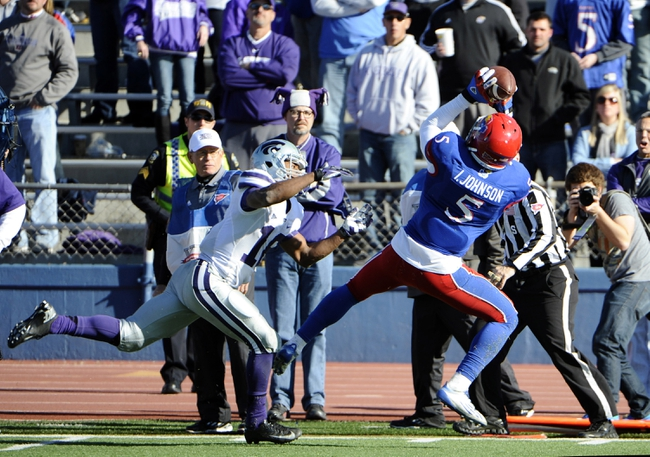 Nov 30, 2013; Lawrence, KS, USA; Kansas Jayhawks safety Isaiah Johnson (5) intercepts a pass intended for Kansas State Wildcats wide receiver Tyler Lockett (16) in the second half at Memorial Stadium. Kansas State won the game 31-10. Mandatory Credit: John Rieger-USA TODAY Sports