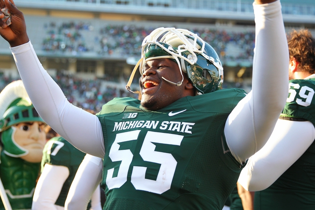 Nov 30, 2013; East Lansing, MI, USA; Michigan State Spartans defensive tackle Devyn Salmon (55) celebrates the win after a game against the Minnesota Golden Gophers at Spartan Stadium. Mandatory Credit: Mike Carter-USA TODAY Sports