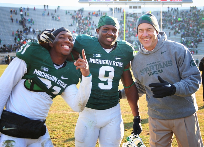 Nov 30, 2013; East Lansing, MI, USA; Michigan State Spartans head coach Mark Dantonio and safety Isaiah Lewis (9) and cornerback Darqueze Dennard (31) celebrate after a game against the Minnesota Golden Gophers at Spartan Stadium.MSU won 14-3.  Mandatory Credit: Mike Carter-USA TODAY Sports