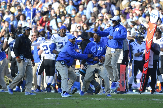 Nov 30, 2013; Chapel Hill, NC, USA;  Duke Blue Devils coaches react on the sidelines after Duke Blue Devils cornerback DeVon Edwards (27) (not pictured) intercepts at the end of the fourth quarter. The Duke Blue Devils defeated the North Carolina Tar Heels 27-25 at Kenan Memorial Stadium. Mandatory Credit: Bob Donnan-USA TODAY Sports