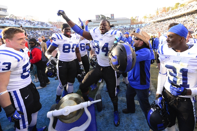 Nov 30, 2013; Chapel Hill, NC, USA;  Duke Blue Devils linebacker Chris Hoover (53) and tight end David Reeves (80) and defensive end Kenny Anunike (84) and cornerback Breon Borders (31) with the victory bell after the game. The Duke Blue Devils defeated the North Carolina Tar Heels 27-25 at Kenan Memorial Stadium. Mandatory Credit: Bob Donnan-USA TODAY Sports