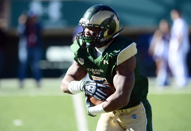 Nov 30, 2013; Fort Collins, CO, USA; Colorado State Rams running back Kapri Bibbs (5) carries in the first quarter against the Air Force Falcons at Hughes Stadium. Mandatory Credit: Ron Chenoy-USA TODAY Sports